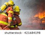 2 firefighters spraying water... | Shutterstock . vector #421684198