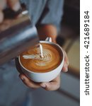 coffee latte art make by barista | Shutterstock . vector #421689184