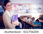 pretty teacher smiling at... | Shutterstock . vector #421756204