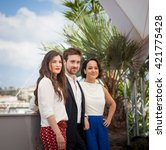 Small photo of Cannes, France - 17 MAY 2016 - Actors Amandine Truffy, Gregoire Leprince-Ringuet and Pauline Caupenne attend the 'La Foret De Quinconces' photocall during the 69th Annual Cannes Film Festival