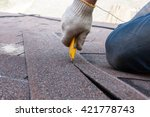 roofer worker cuts shingles on... | Shutterstock . vector #421778743