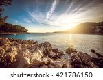 sunset at rocky stone beach at... | Shutterstock . vector #421786150