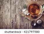 cup of tea and jasmine flower... | Shutterstock . vector #421797580