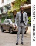 african businessman outdoors  | Shutterstock . vector #421807330
