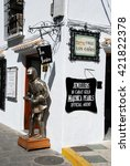 Small photo of MIJAS, SPAIN - JUNE 14, 2008 - Suit of armour outside a shop on the corner of Calle Los Canos, Mijas, Malaga Province, Andalucia, Spain, Western Europe, June 14, 2008.