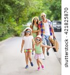 Small photo of Happy young family walking with guitar spending carefree time together. Travel and holiday concept