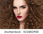 beauty young woman with curly... | Shutterstock . vector #421882900