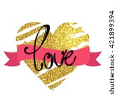 "gold heart. the word ""love""... 
