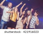 happy friends dancing in a club | Shutterstock . vector #421916023