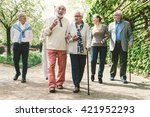 group of old people walking... | Shutterstock . vector #421952293