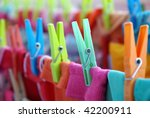 Stock photo close up of colorful laundry pins and hanged clothes drying 42200911