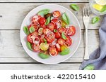 tomatoes salad with basil and... | Shutterstock . vector #422015410
