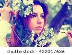 women in park branch tree flower | Shutterstock . vector #422017636