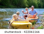 Family Kayaking On The River....