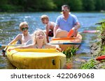family kayaking on the river.... | Shutterstock . vector #422069068