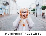 Young Girl Listening Music In...