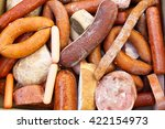 Small photo of tainted meat products. stale frankfurter and sausages. a lot of sausages with mold. top view