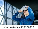 woman wearing virtual reality... | Shutterstock . vector #422208298