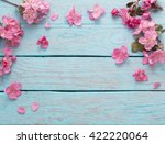 Stock photo apple flowers on wooden background 422220064