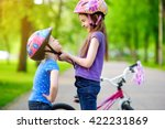 adorable girl helping her... | Shutterstock . vector #422231869