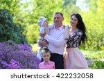 happy young family walking in...   Shutterstock . vector #422232058