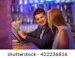 smiling man at bar counter with ... | Shutterstock . vector #422236816
