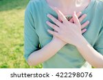 asian woman putting her hands... | Shutterstock . vector #422298076