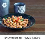 Small photo of Salt bean admix and Japanese sake on old wooden table / select focus