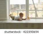 cheerful baby in light trousers ... | Shutterstock . vector #422350654
