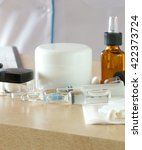 Small photo of Medication for non-surgical cosmetic procedures on a table of a dermatologist in a aesthetic centre.
