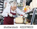 Salesman Slicing Cheese With...