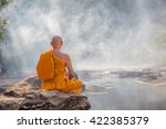 Meditating Monks In The Forest
