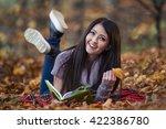 girl reading a book | Shutterstock . vector #422386780