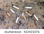 cigarettes butt in ashtray | Shutterstock . vector #422421076