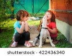 two girls playing with a beagle ...   Shutterstock . vector #422436340