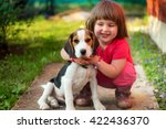 cute little girl with a beagle... | Shutterstock . vector #422436370