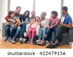 happy family sitting on sofa in ... | Shutterstock . vector #422479156