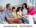 family sitting on sofa and... | Shutterstock . vector #422526853