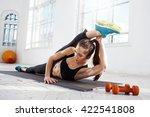 beautiful slim brunette  doing... | Shutterstock . vector #422541808