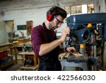 carpenter working on his craft... | Shutterstock . vector #422566030