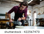 carpenter working on his craft... | Shutterstock . vector #422567473