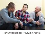 three men having a serious... | Shutterstock . vector #422677048