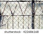vintage fence of metal mesh | Shutterstock . vector #422686168