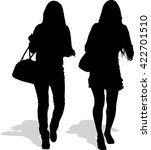 silhouettes of two going girls  | Shutterstock .eps vector #422701510