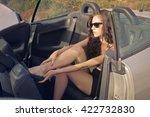 beautiful woman in her car | Shutterstock . vector #422732830