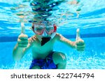 Happy Little Boy Swimming...