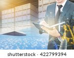 Small photo of Double exposure of business man analyzing report and business center city with blurred cargo in wooden case at warehouse and export plane aeriel background, exportation and trading concept
