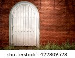 Wood Arch Door On Red Brick...