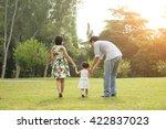happy asian family walking on... | Shutterstock . vector #422837023
