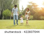 happy asian family walking on... | Shutterstock . vector #422837044